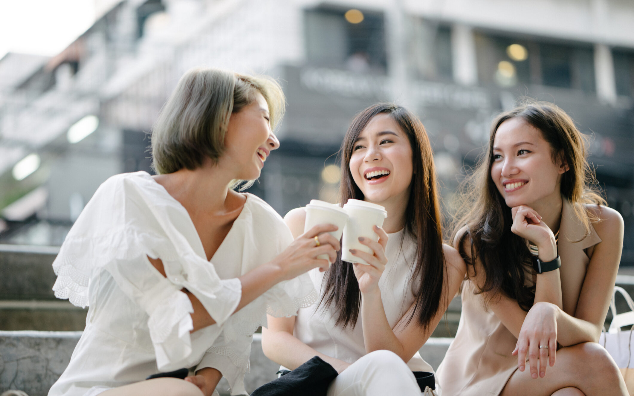 Women friends out for shopping in city streets